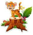 cartoon funny baby tiger posing on tree stump vector image