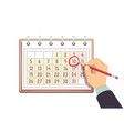 hand with pen marks date in calendar deadline and vector image