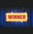 Winner light bulb frame on blue curtain background