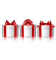 Three white gift boxes with a red bows vector image vector image