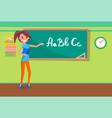 teacher writing alphabet on chalkboard vector image