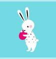 lovely white little bunny holding decorated egg vector image