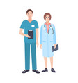 pair of male and female doctors wearing scrubs and vector image vector image