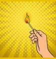 hand with burned match pop art vector image