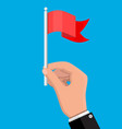 red flag on metal flagpole in hand vector image