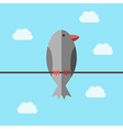 Bird perching on wire vector image