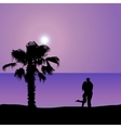 Loving couple on the seashore at night vector image