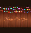 glowing garland on wood background vector image
