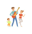 dad playing guitar while his son and wife dancing vector image vector image