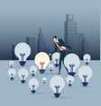 businessman look the only bright light bulb vector image vector image