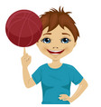 little boy spinning basketball ball with finger vector image