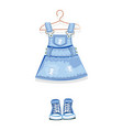 denim dress on a hanger and denim sneakers vector image vector image