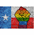 lgbt protest fist on a texas brick wall flag vector image