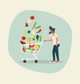 man with vegetables in shopping cart vector image vector image