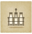 milk bottles in basket on old background vector image vector image