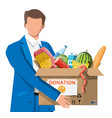 man holding cardboard box full food vector image