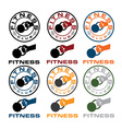 grunge kettlebell in the hand fitness emblems vector image vector image