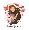 girl holding a cat in her arms spring mood vector image
