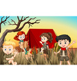 Boys and girls camping out in the field vector image vector image