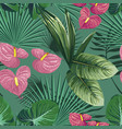green tropical leaves and flowers seamless pattern vector image vector image