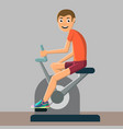 man is engaged in training on a stationary bike vector image
