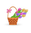 flat wicker basket with flowers easter icon vector image