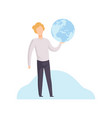 young man holding earth globe in his hands vector image vector image