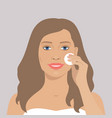 beautiful woman cleaning her face vector image vector image