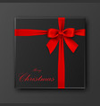 black gift box with merry christmas text red bow vector image vector image