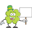Cartoon shamrock holding a sign vector image vector image