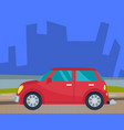 red car riding down road in urban landscape vector image