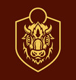 buffalo head silhouette on shield emblem vector image