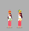cute balinese girl bring fruit offerings for rite vector image vector image