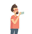 casual man holding mobile phone gadget in hand vector image