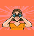 girl looking through binoculars pop art retro vector image vector image