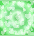green heart bokeh pattern vector image
