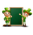 man and girl cartoon leprechaun with green chalkbo vector image