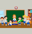 group of elementary school kids in the class room vector image vector image