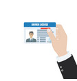 hand holds a driver license indification card vector image