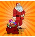 Pop Art Smiling Santa Claus with Bag Gifts vector image
