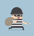 Thief cartoon holding knife in his hand and carryi vector image