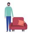 man standing near sofa with cushion vector image vector image
