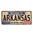welcome to arkansas vintage rusty metal sign vector image vector image