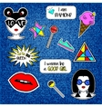 Trendy fashionable pins patches on denim blue vector image