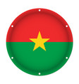 round metal flag of burkina faso with screw holes vector image vector image