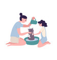 happy mother and daughter washing cat at home vector image
