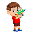 boy playing with water gun vector image vector image