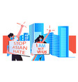 stop asian hate couple in masks holding banners vector image vector image