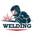 welder in helmet with a welding machine in hand vector image vector image