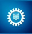 wheat and gear icon isolated on blue background vector image
